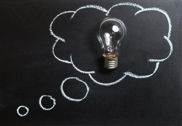 Light bulb in thought bubble indicating a bright idea