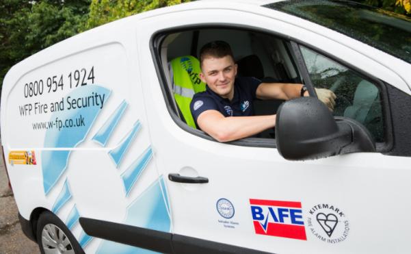 WFP Engineer smiling in a van