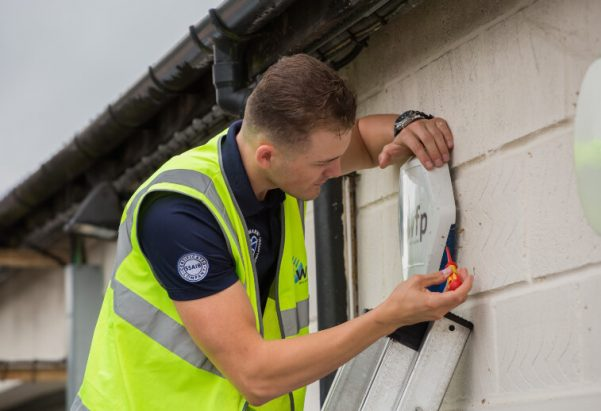 WFP Engineer working on an external bell box on a building