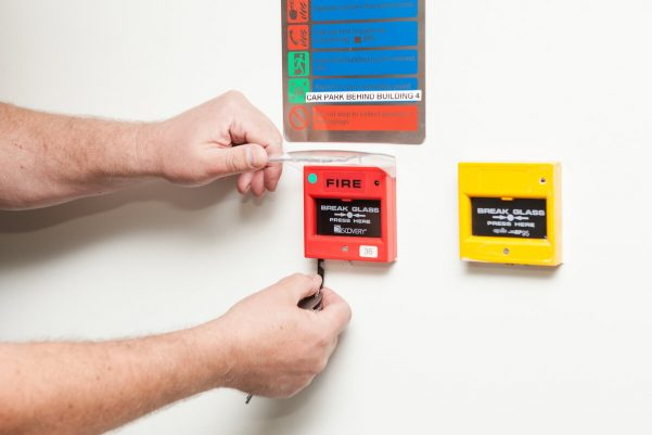 Fire alarm manual call point being tested by a WFP Engineer