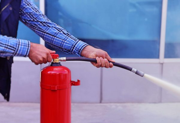 Close up of fire extinguisher being used