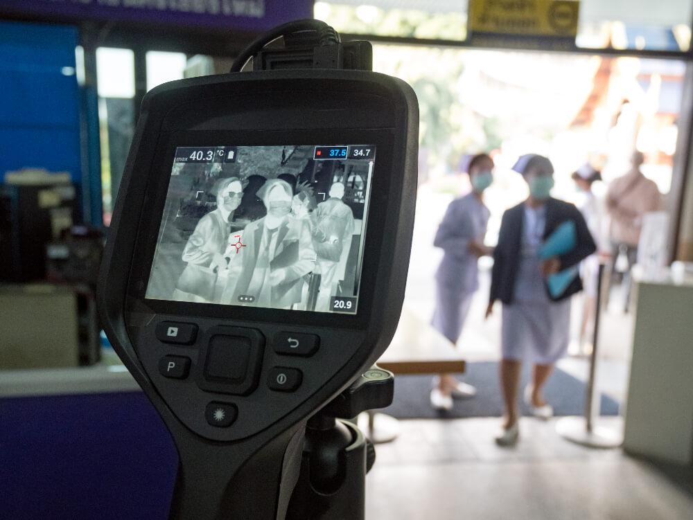 Thermal camera visual of nurses entering a premises