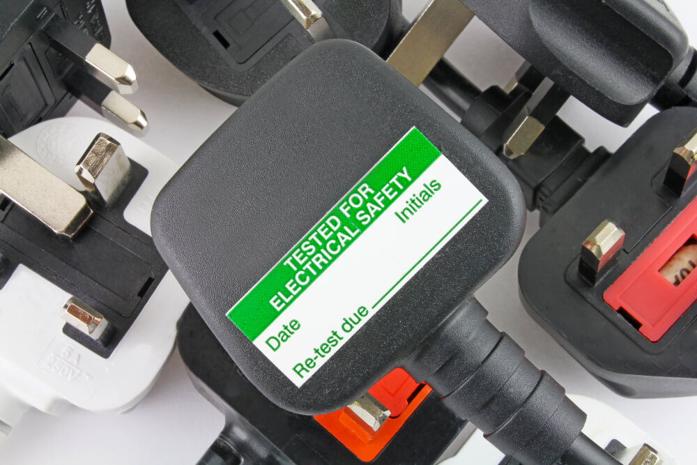 Plugs with a green sticker on to indicate testing has been done