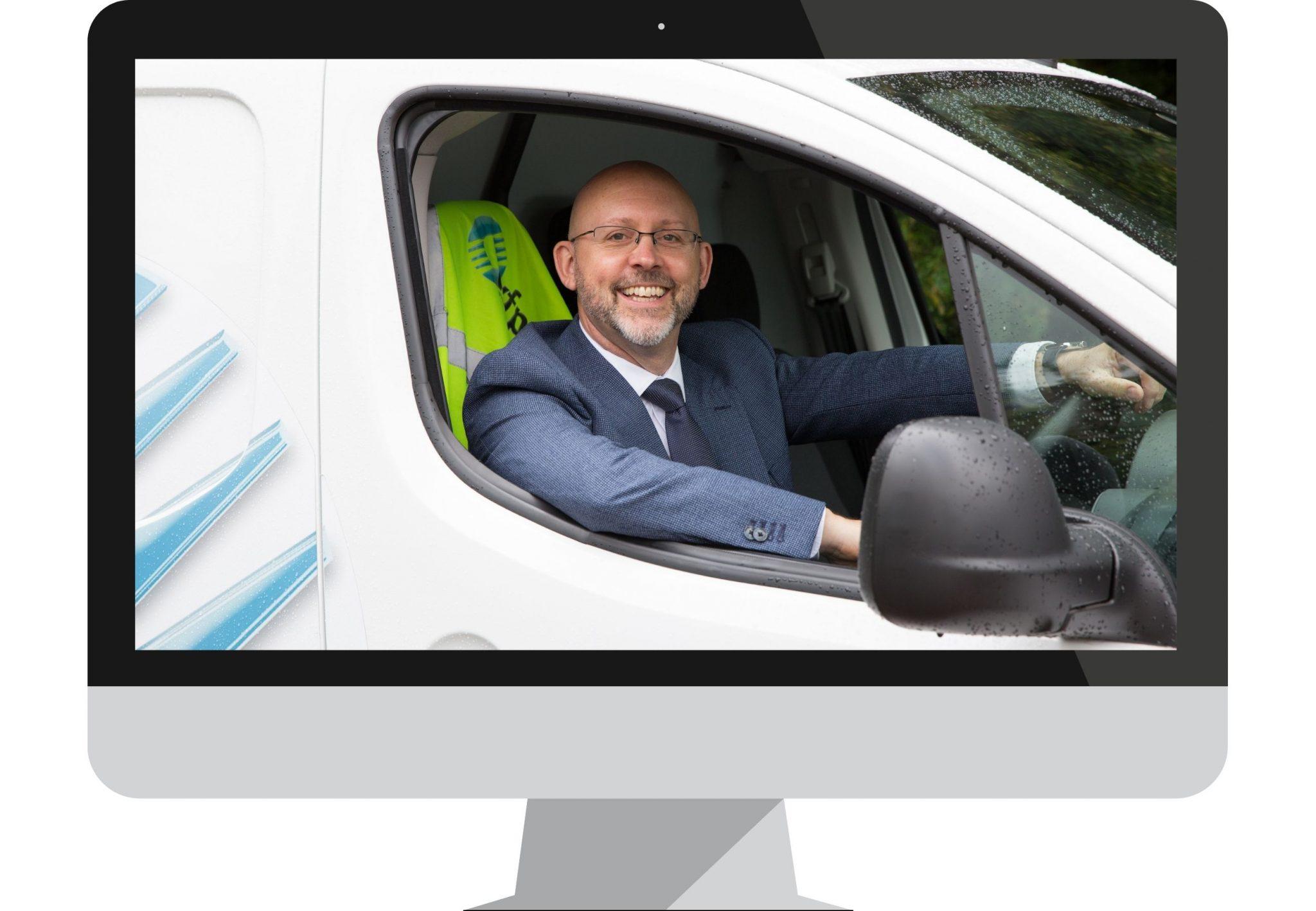 Paul Field, Founding Director, in a van